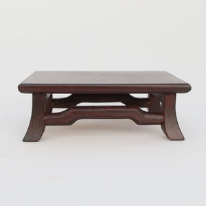Wooden table under the bonsai