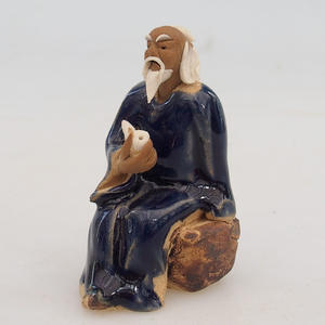 Ceramic figurine - sage with fajfkou