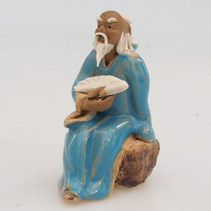 Ceramic figurine - a sage with a fan