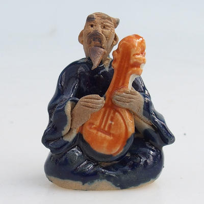 Ceramic figurine - a sage with a guitar - 1